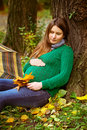 Pregnant woman slipping in the park Royalty Free Stock Photos