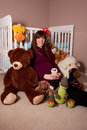 Pregnant woman with stuffed toys Royalty Free Stock Photo