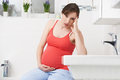 Pregnant Woman Suffering With Morning Sickness In Bathroom Royalty Free Stock Photo