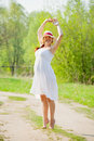 Pregnant woman on summer road Royalty Free Stock Photo