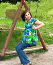 Pregnant woman on swing Stock Photography