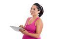 Pregnant woman with tablet pc beautiful hispanic swiping a isolated on white Royalty Free Stock Photography
