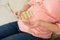 Pregnant Woman Taking Vitamin Pill At Home Royalty Free Stock Photo