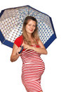 A Pregnant Woman With An Umbre...