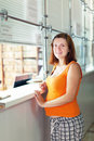 Pregnant woman waiting  for patient's records Royalty Free Stock Photo