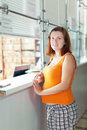 Pregnant woman waiting  for patient's records in clinic Royalty Free Stock Photo