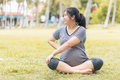 Pregnant woman work out in the garden. Royalty Free Stock Photo