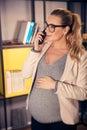 Pregnant woman at work Royalty Free Stock Photo