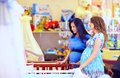 Pregnant women choosing cot for baby babies Stock Photos