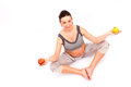 Pregnant yoga woman in position with fruits refers to healthy lifestyle Royalty Free Stock Images
