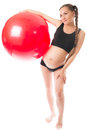 Pregnant young woman doing exercise on fitball Stock Photo