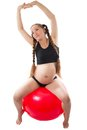 A pregnant young woman doing exercise on fitball Royalty Free Stock Photo