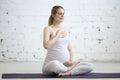 Pregnant young woman doing prenatal yoga. Pranayama Royalty Free Stock Photo
