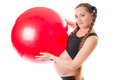 Pregnant  young woman and red fitness ball Stock Photography