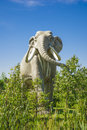 Prehistoric elephant jurassic park sculpture of living in forest Stock Images