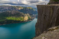 Preikestolen - landscape of tourists at the top of spectacular Pulpit Rock cliff and surrounding fjords, Norway Royalty Free Stock Photo