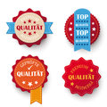 Premium quality labels with german text qualität geprüfte translate checked Stock Photography