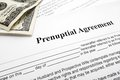 Prenup and cash closeup of a marriage prenuptial agreement Stock Photos