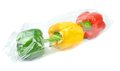 Prepacked paprika peppers fresh sealed in a cellophane bag Stock Photography