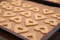 Preparation of cakes dough hearts on sheet ready for baking in the oven Stock Image