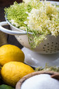 Preparation of homemade elderflower cordial on wooden table Royalty Free Stock Images