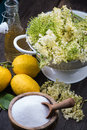 Preparation of homemade elderflower cordial on wooden table Royalty Free Stock Photo