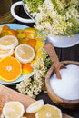 Preparation of homemade elderflower cordial on wooden table Stock Photo