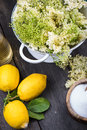 Preparation of homemade elderflower cordial on wooden table Royalty Free Stock Photography