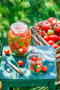 Preparation for pickled tomatoes in summer on old wooden table Stock Image