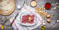 Preparation of raw minced meat balls with egg breadcrumbs eggs paste tomato sauce, garlic herb seasoning knife sliced onions Royalty Free Stock Photo