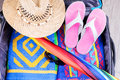 Preparation travel suitcase for the summer trip Royalty Free Stock Photo