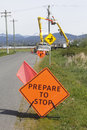 Prepare to stop sign a warns motorists as a hydro crew works up ahead Stock Images