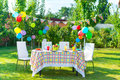 Prepared birthday table in summer green garden Stock Images