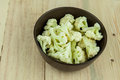 Prepared Cauliflower decorated in bowl over wooden background. Royalty Free Stock Photo