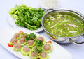 Prepared hot pot of fish ball with bitter melon on white platter Royalty Free Stock Photo