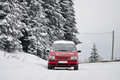 Prepared for winter car season on a mountain road covered with ice and snow Stock Image