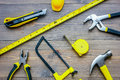 Preparing for appartment repair. Set of construction tools on wooden table background top view