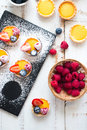 Preparing berries tartlets Royalty Free Stock Photo