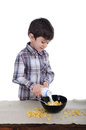Preparing breakfast of corn flakes and milk preschool boy is is Stock Images