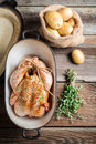 Preparing chicken for cooking with spices on old wooden table Royalty Free Stock Photography
