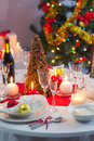 Preparing for christmas eve at beautifully decorated table in home Stock Photo