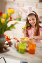 Preparing Easter basket with colored eggs Royalty Free Stock Photo