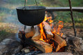 Preparing food on campfire Royalty Free Stock Photo