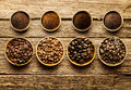 Preparing fresh roast coffee beans to brew with an overhead view of four different varieties of with their corresponding Stock Photos