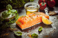 Preparing a gourmet salmon meal Royalty Free Stock Photo