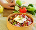 Preparing a Greek salad Royalty Free Stock Photos