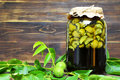 Preparing green walnut liqueur