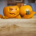 Preparing for halloween carving up pumpkins into jack o lanterns Royalty Free Stock Photos