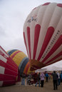 Preparing the hot air baloons spectators looking at inflation Stock Photos