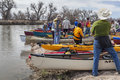 Preparing kayaks and canoes for launch south platte river evans colorado april a during annual all club paddle on april it is a Royalty Free Stock Photos